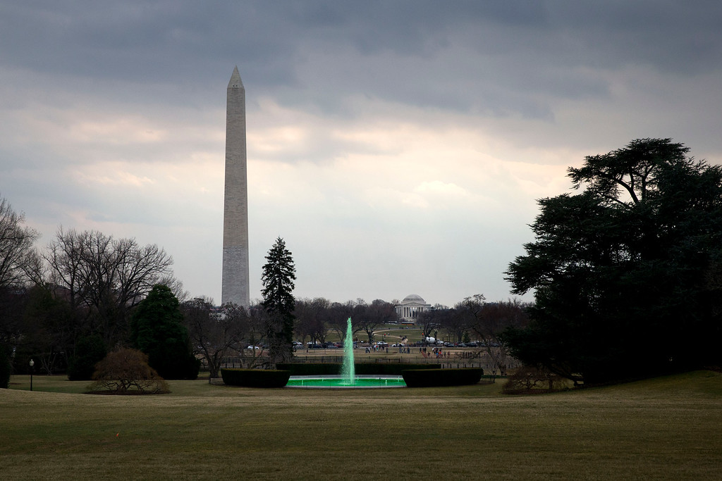 ". With the Washington Monument and Jefferson Memorial in the background, the fountain on the South Lawn of the White House in Washington, is dyed green for St. Patrick\'s Day, Tuesday, March 17, 2015, prior to President Barack Obama\'s motorcade taking the president to Capitol Hill for a ""Friends of Ireland\"" luncheon. (AP Photo/Jacquelyn Martin)"