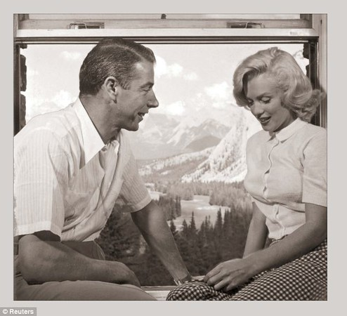 """Credit: Reuters - Joe DiMaggio and Marilyn Monroe during shooting of """"The River of No Return"""".  Note the view from window in room at Banff Springs Hotel"""