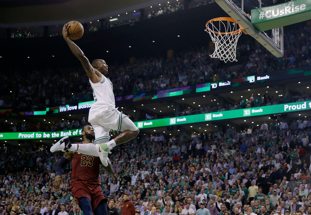 . Boston Celtics guard Terry Rozier soars toward the basket past Cleveland Cavaliers forward LeBron James during the second half in Game 2 of the NBA basketball Eastern Conference finals Tuesday, May 15, 2018, in Boston. (AP Photo/Charles Krupa)