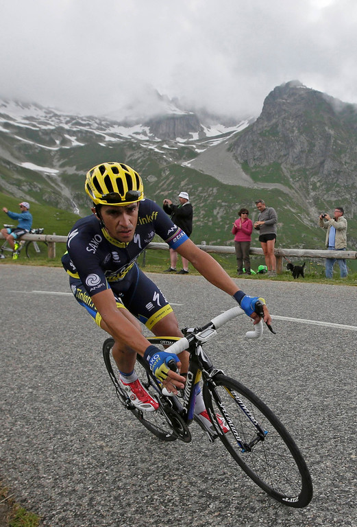 . Team Saxo-Tinkoff rider Alberto Contador of Spain cycles during the 204.5 km stage of the centenary Tour de France cycling race from Bourg d\'Oisans to Le Grand Bornand, in the French Alps, July 19, 2013.   REUTERS/Jacky Naegelen