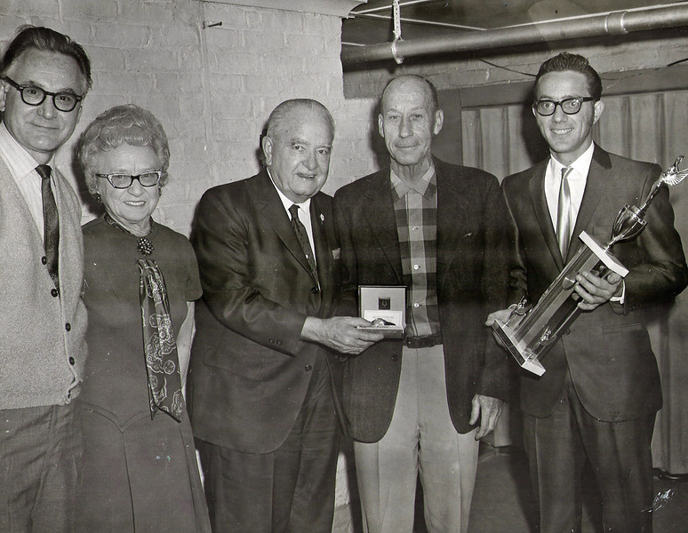 Pictured here is Mayor Biertuempfel presenting a watch to Mr Vernon Davies, one of the founders of the Union Model Airplane Club; the other founder was Harold Denk, Union Fire Chief (not pictured).Far right is Frank DiCicco and far left is Bill Hotra. Information provided by Richard A. Pisz, former UMAC member.