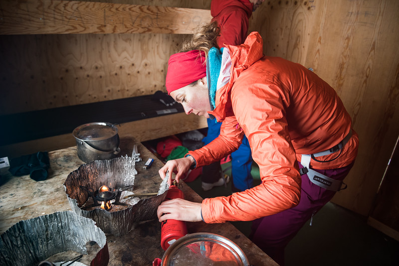 Antonia Cox lighting a stove