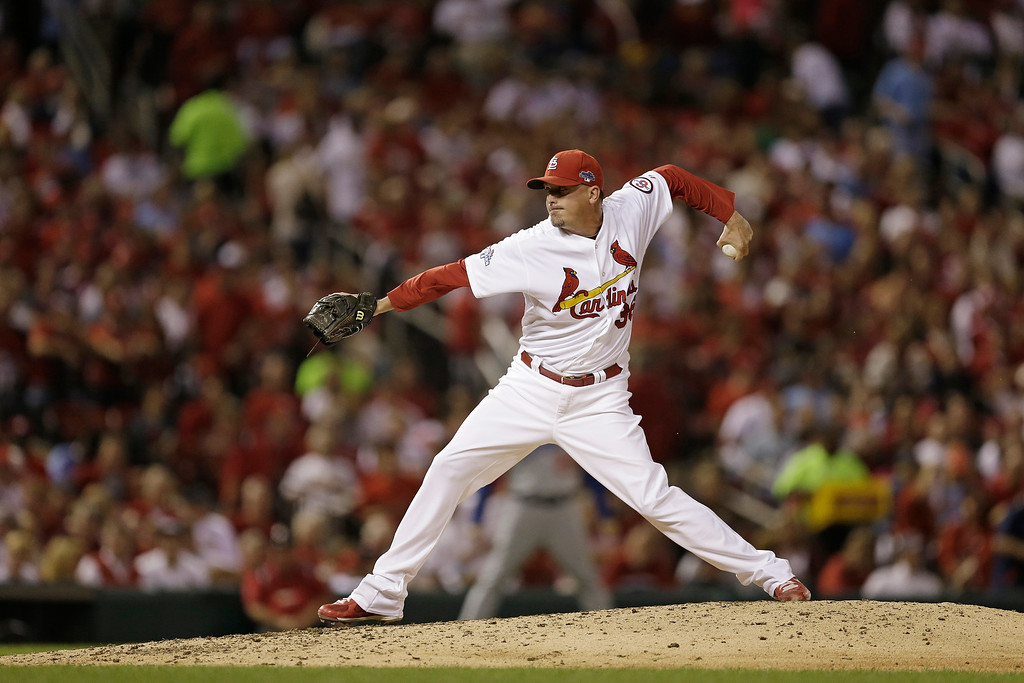 . St. Louis Cardinals relief pitcher Randy Choate (36) works during the seventh inning of Game 1 of the National League baseball championship series against the Los Angeles Dodgers, Friday, Oct. 11, 2013, in St. Louis. (AP Photo/Jeff Roberson)