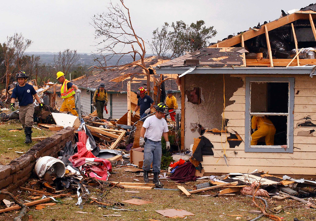 . Rescue workers comb through debris May 16, 2013 after tornados swept through the town of Granbury, Texas late May 15. REUTERS/Richard Rodriguez