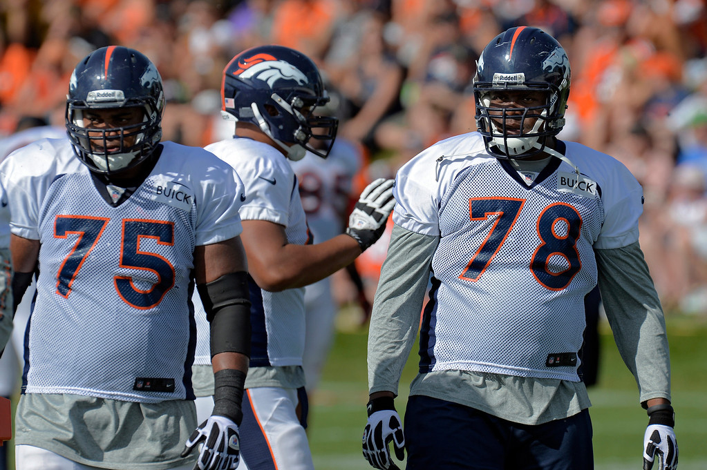 . Denver Broncos Chris Clark (75) and T Ryan Clady (78) watch drills during training camp August 6, 2013 at Dove Valley. (Photo By John Leyba/The Denver Post)