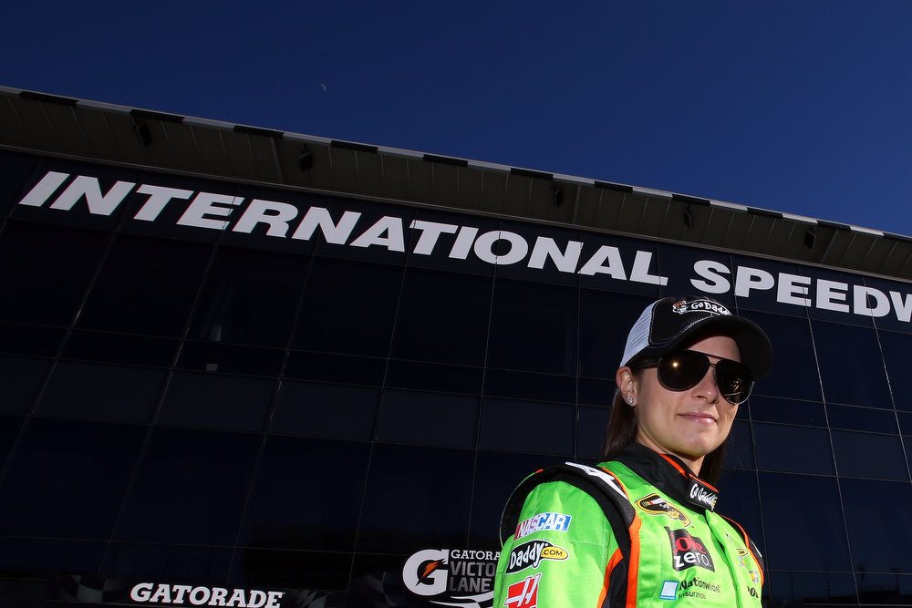 Description of . Danica Patrick, driver of the #10 GoDaddy.com Chevrolet, looks on after winning the pole award for the NASCAR Sprint Cup Series Daytona 500 at Daytona International Speedway on February 17, 2013 in Daytona Beach, Florida.  (Photo by Jonathan Ferrey/Getty Images)
