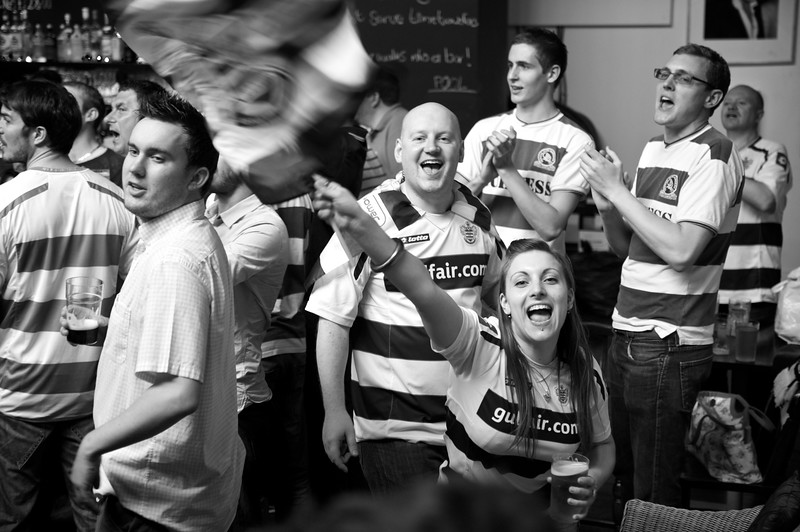Queens Park Rangers fans celebrating promotion to the English Premier League after a fifteen year absence from the top flight.<br /> <br /> This was in the now closed Green Rooms pub in Shepherds Bush.