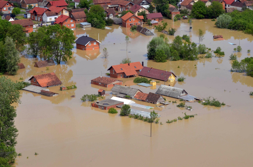 . This image taken on taken Sunday, May 18, 2014 and made available by the Bosnia Army shows an aerial view of the flooded area near the Bosnian town of Brcko along the river Sava, 200 kms north of Bosnian capital of Sarajevo. Three months\' worth of rain fell on the Balkan region in three days, producing the worst floods since rainfall measurements began 120 years ago. (AP Photo/Bosnia Army)