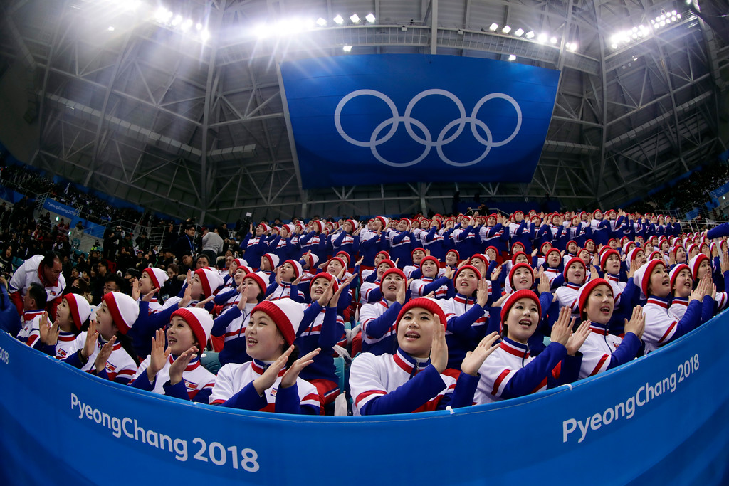 . Supporters from North Korea cheer before the preliminary round of the men\'s hockey game between the Czech Republic and South Korea at the 2018 Winter Olympics in Gangneung, South Korea, Thursday, Feb. 15, 2018. (AP Photo/Frank Franklin II)
