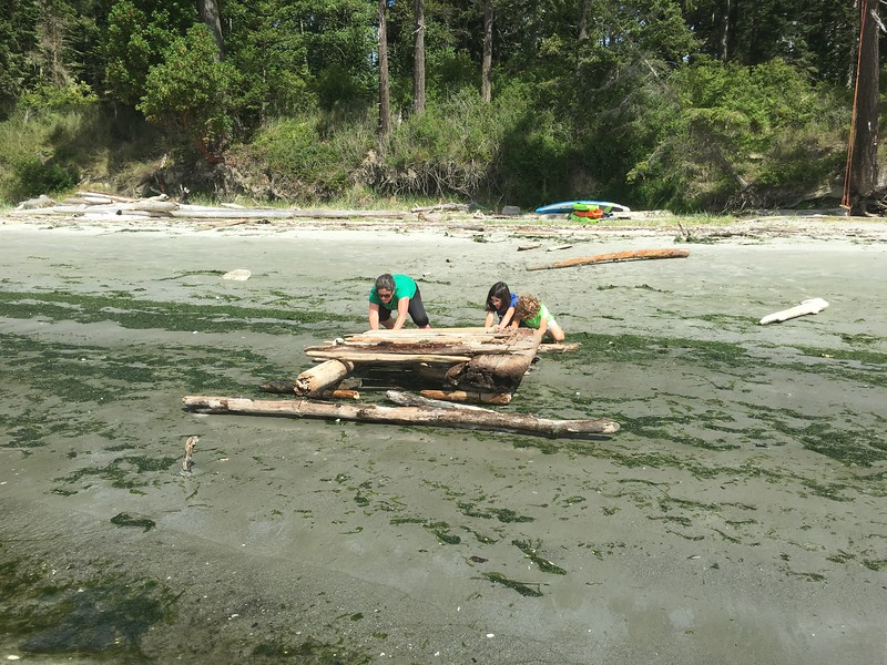 "built a ""road"" to trundle the raft to the water"