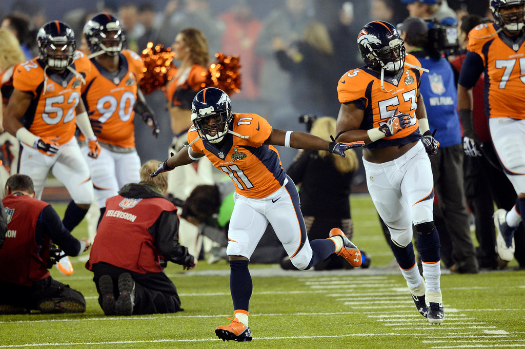 . Denver Broncos wide receiver Trindon Holliday (11) runs onto the field with the rest of the team.  The Denver Broncos vs the Seattle Seahawks in Super Bowl XLVIII at MetLife Stadium in East Rutherford, New Jersey Sunday, February 2, 2014. (Photo by AAron Ontiveroz/The Denver Post)