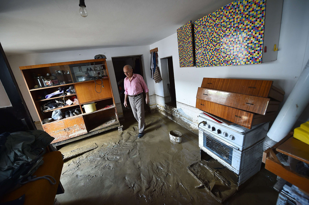 . A man walks through a mud covered room in his flooded house  in Krupanj, some 130 kilometers southwest of Belgrade, on May 20, 2014, after the western Serbian town was hit with floods and landslides, cutting it off for four days. Serbia declared three days of national mourning on May 20 as the death toll from the worst flood to hit the Balkans in living memory rose and health officials warned of a possible epidemic.   AFP PHOTO / ANDREJ  ISAKOVIC/AFP/Getty Images