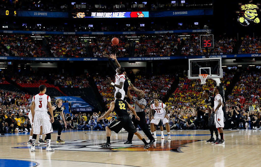 . ATLANTA, GA - APRIL 06:  Carl Hall #22 of the Wichita State Shockers and Gorgui Dieng #10 of the Louisville Cardinals go after the opening jump ball to start the 2013 NCAA Men\'s Final Four Semifinal at the Georgia Dome on April 6, 2013 in Atlanta, Georgia.  (Photo by Kevin C. Cox/Getty Images)