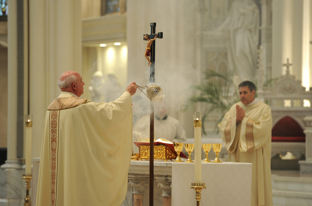 . DENVER, CO- MARCH 13:   Monsignor Thomas Fryar, Moderator of the Curia, leads the afternoon mass at the Cathedral Basilica of the Immaculate Conception in Denver, CO on March 13th, 2013 after the announcement of the new pope. Jorge Mario Bergoglio, who will be called Francis, will be the 266th pontiff of the Roman Catholic Church. He is also the first non-European pope in more than 1,200 years and the first member of the Jesuit order to lead the church. (Photo By Helen H. Richardson/ The Denver Post)