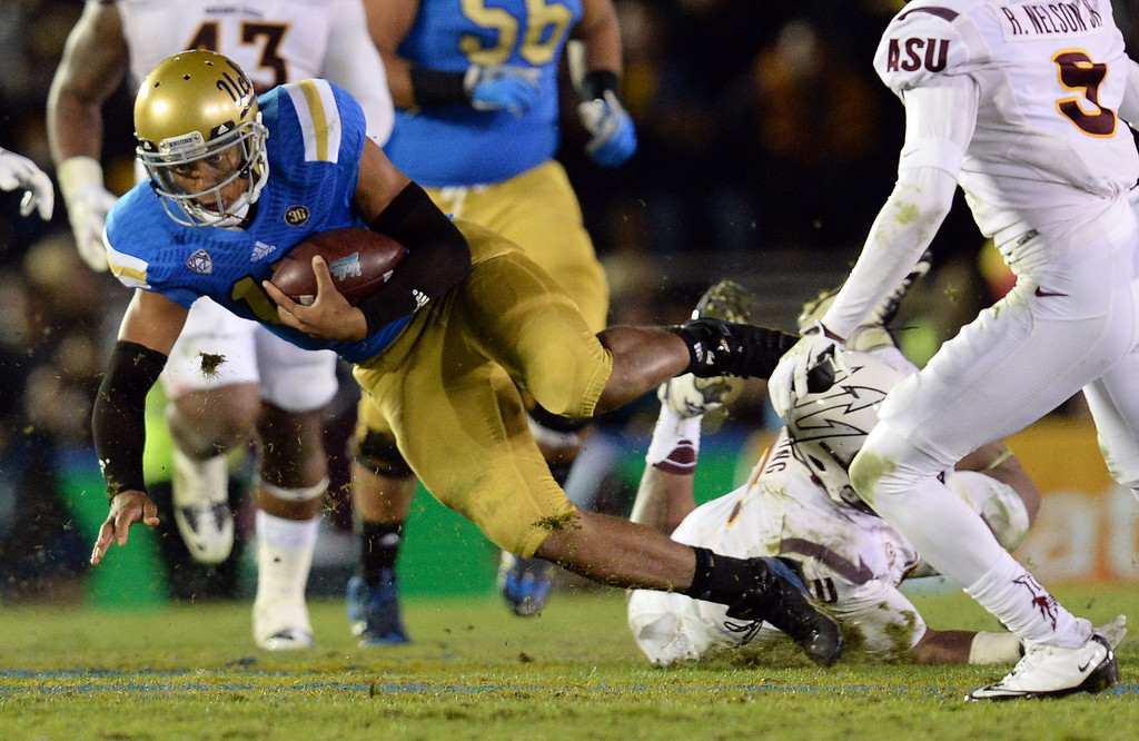 . UCLA�s Brett Hundley #17 picks up some yards during their game against Arizona State at the Rose Bowl Saturday November 23, 2013. Arizona State beat UCLA 38-33. (Photos by Hans Gutknecht/Los Angeles Daily News)