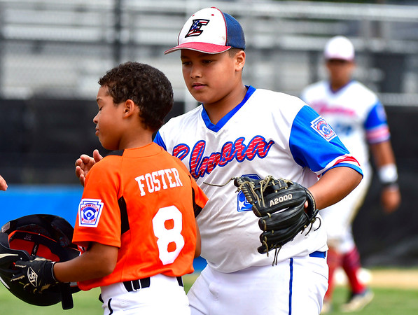 8/7/2019 Mike Orazzi | Staff New Jersey's Derek Escobar (2) consoles Pennsylvania's Eric Foster Jr (8) after a loss during Wednesday's Eastern Regional Little League Baseball game at Breen Field in Bristol.