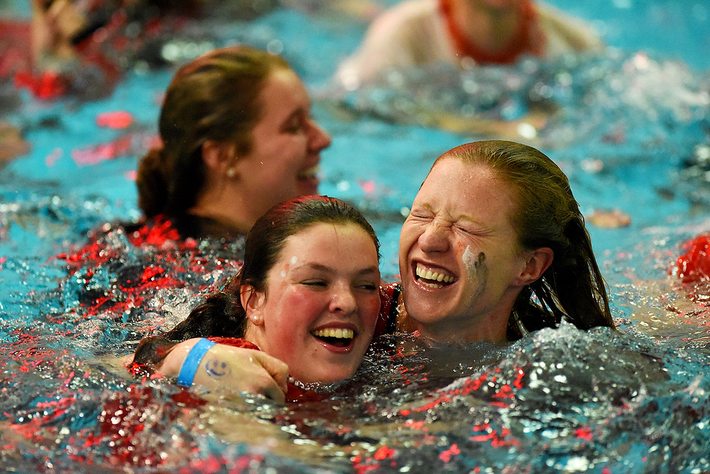 . Fairview\'s Katie Boselli, left, and backstroke coach Jen Koschmann celebrate winning the state title at the girls 5A State Swim meet held at Edora Pool and Ice Center on Saturday. (Photo by Kira Horvath/ The Denver Post)