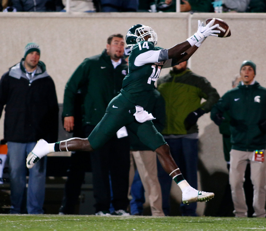 . Michigan State receiver Tony Lippett (14) catches a 55-yard pass for a touchdown against Nebraska during the first quarter of an NCAA college football game, Saturday, Oct. 4, 2014, in East Lansing, Mich. (AP Photo/Al Goldis)