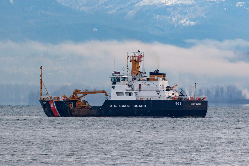 Coast guard ship on the ocean with clouds in the background