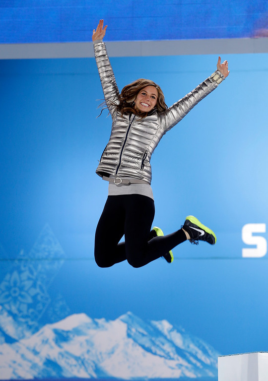 . Women\'s skeleton silver medalist Noelle Pikus-Pace of the United States jumps on the podium in celebration during the medals ceremony at the 2014 Winter Olympics, Saturday, Feb. 15, 2014, in Sochi, Russia. (AP Photo/David J. Phillip )