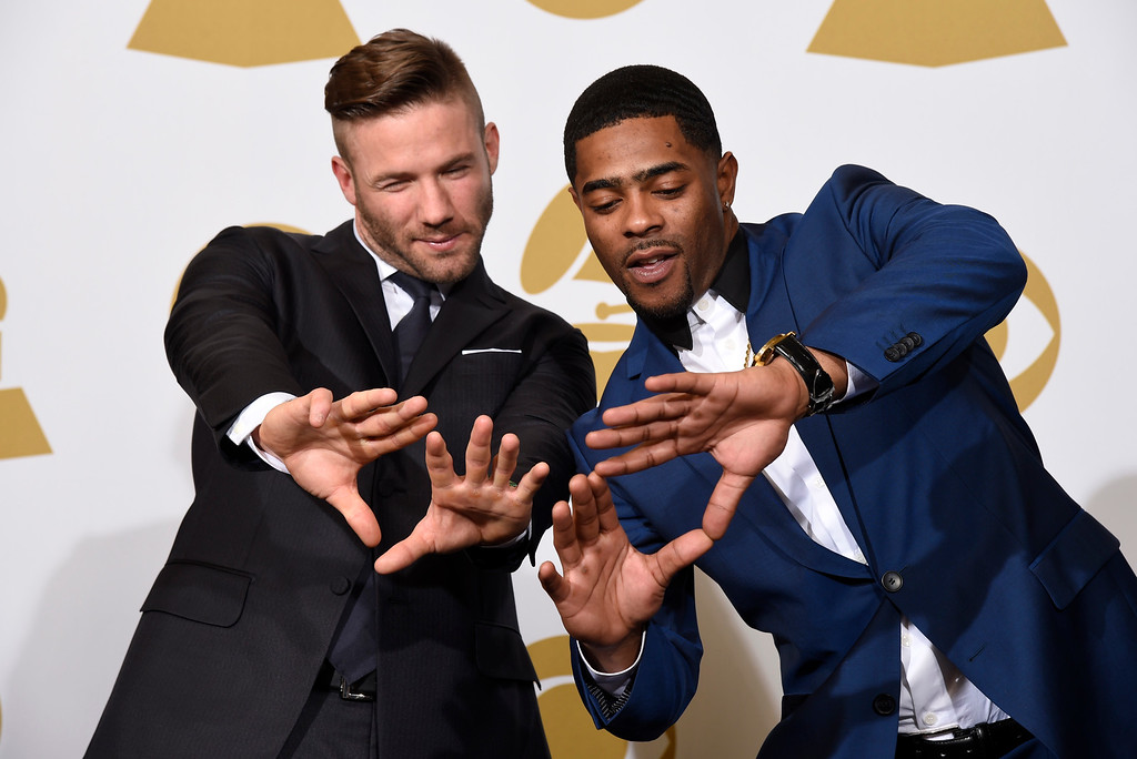 . New England Patriots football players Julian Edelman, left, and Malcolm Butler pose in the press room at the 57th annual Grammy Awards at the Staples Center on Sunday, Feb. 8, 2015, in Los Angeles. (Photo by Chris Pizzello/Invision/AP)