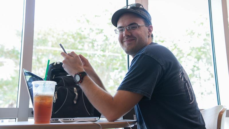 Islander student Greg Rominski works on creating his own songs in the University Center.