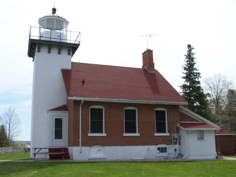 Sherwood Point Lighthouse: To the far right is the fuel storage building made of red brick with a red roof.