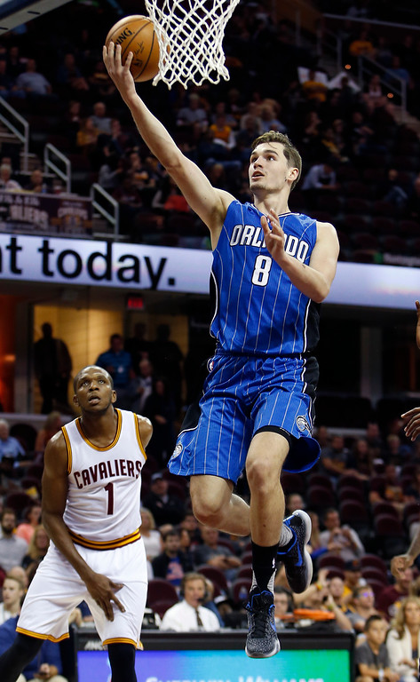 . Orlando Magic\'s Mario Hezonja shoots against Cleveland Cavaliers\' James Jones (1) during the second half of an NBA preseason basketball game Wednesday, Oct. 5, 2016, in Cleveland. The Cavaliers won 117-102. (AP Photo/Ron Schwane)