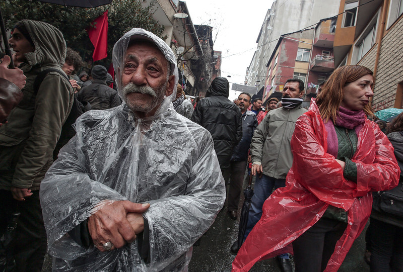 . People follow the coffin of Berkin Elvan, a Turkish teenager who was in a coma since being hit on the head by a tear gas canister fired by police during last summer\'s anti-government protests, in Istanbul, Turkey, Tuesday, March 11, 2014. The 15-year old Berkin Elvan�s death in an Istanbul hospital nine months after he fell into a coma  looked likely to spark new protests in Turkey. Elvan, who turned 15 in January was caught up in the protests on his way to a shop to buy bread.(AP Photo/Emrah Gurel)