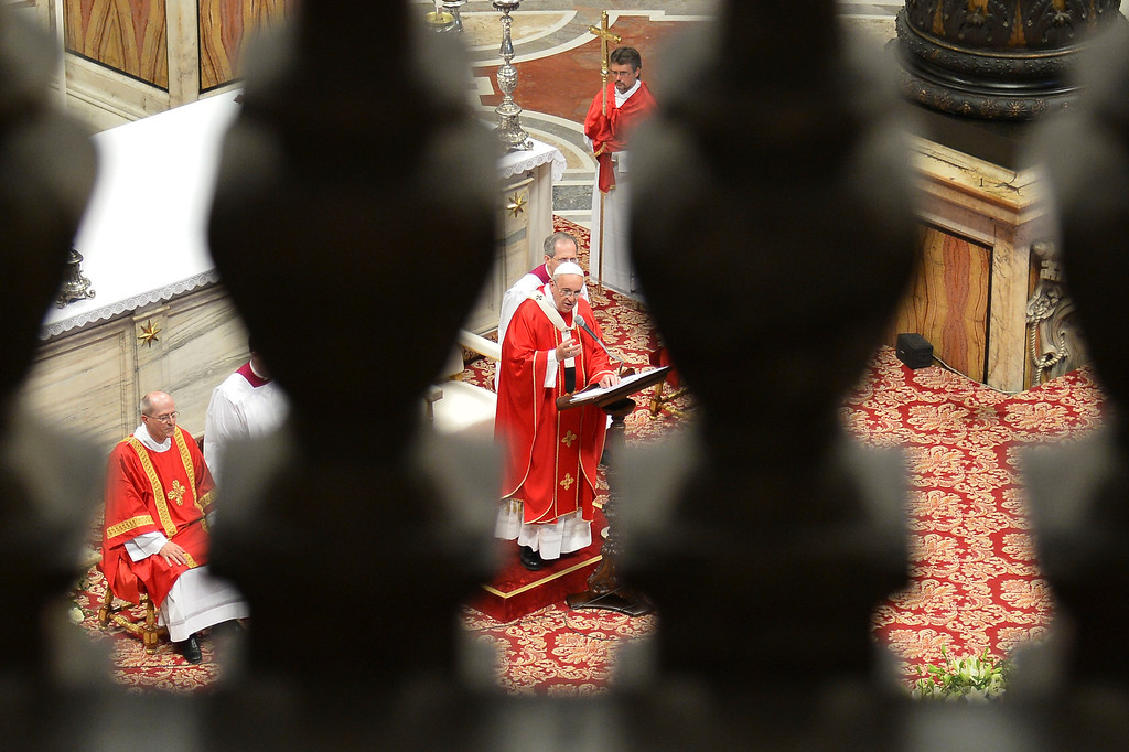 . Pope Francis is framed by a balcony as he weds 20 couples in St. Peter\'s Basilica, at the Vatican, Sunday, Sept. 14, 2014. (AP Photo/Alberto Pizzoli, pool)