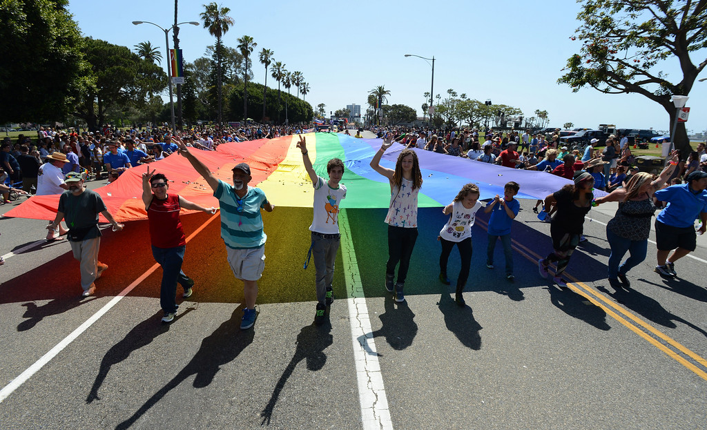 . Long Beach, Calif., -- 05-19-13- Supporters of the AIDS Food Store in Long Beach march in The 30th Annual Long Beach Gay and Lesbian Pride Parade along Ocean Boulevard Sunday.    Stephen Carr/  Los Angeles Newspaper Group