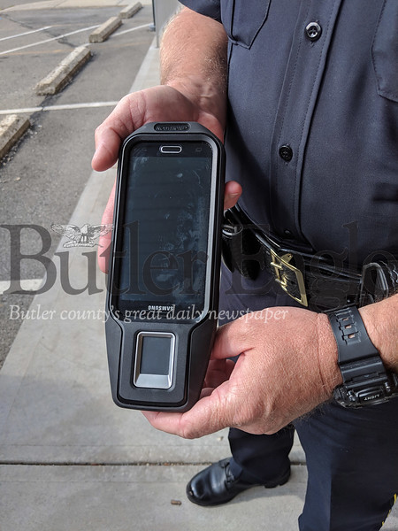 Mobile fingerprint scanners like the one pictured here are helping police quickly identify people and make sure they are who they say they are. (photo by caleb harshberger)