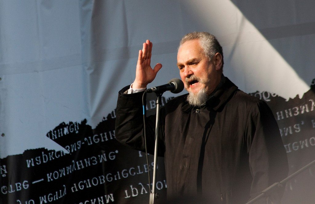 . Andrei Zubov, a history professor who was fired from one of Moscow\'s most prestigious universities last month after criticizing Russia\'s military intervention in Ukraine\'s Crimean Peninsula, speaks to the crowd during a rally against pro-Putin\'s media in Moscow, Russia, Sunday, April 13, 2014. Zubov argued against the annexation of Crimea by comparing it with Nazi Germany\'s annexation of Austria on the eve of World War II. More than 10,000 people have turned out in Moscow for an anti-Kremlin rally to denounce Russian state televisionís news coverage, particularly of the crisis in neighboring Ukraine.(AP Photo/Denis Strelkov)