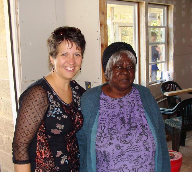 08 11/08 - Cori Lyman-Barner visiting with homeowner Mamie Lue Lillard. kl-b
