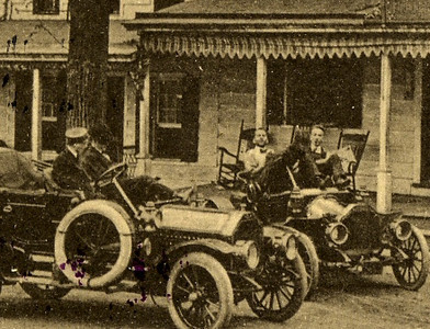 Men in their cars in front of Ye Olde Meeker Inn.