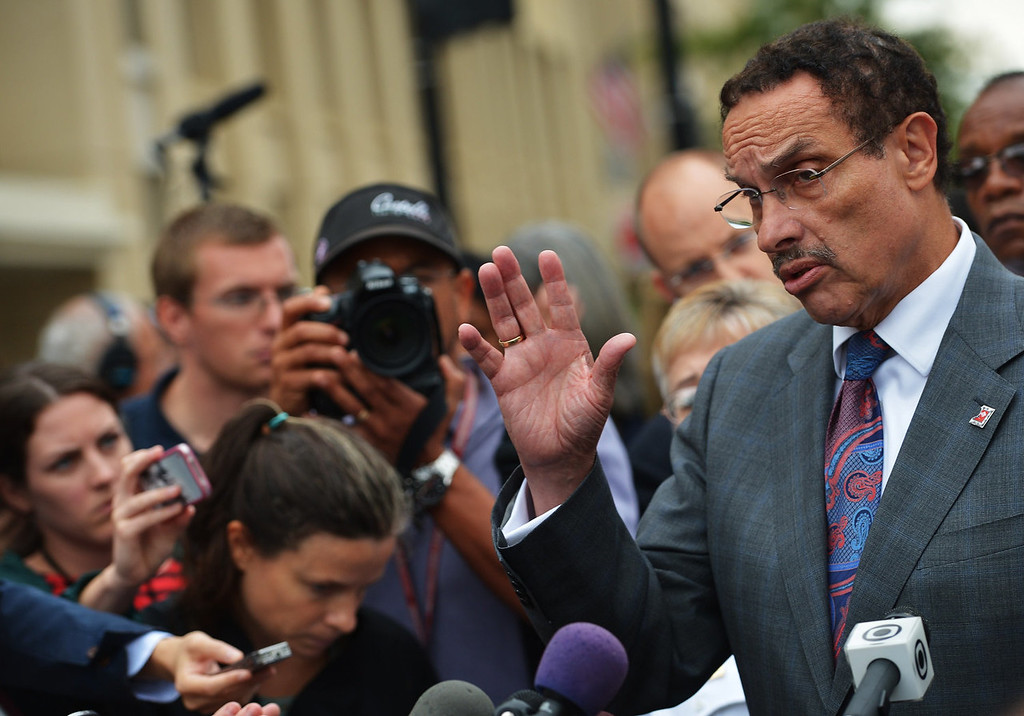 """. District of Columbia Mayor Vincent Gray speaks during a press conference on M Street, SE near the Washington Navy Yard on September 16, 2013 in Washington, DC. At least one unidentified gunman opened fire at the US Navy Yard in Washington on Monday and was at large after killing \""""multiple\"""" victims and wounding several more, officials said. Police and FBI agents descended on the area in force as helicopters swarmed overhead, amid reports a shooter was armed with an assault rifle and was holed up at the complex. \""""We believe there were multiple deaths,\"""" a US defense official, speaking on condition of anonymity, told AFP. The precise death toll remained unclear, the official said. A Washington DC police officer and another law enforcement officer had been shot while the gunman had allegedly barricaded himself in a room in a headquarters building, media reported.   MANDEL NGAN/AFP/Getty Images"""