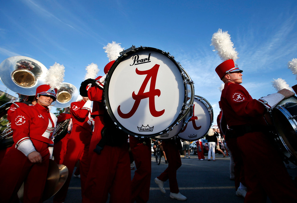. Alabama Crimson Tide band members walk outside Sun Life stadium before the BCS National Championship college football game between Alabama and the Notre Dame Fighting Irish in Miami, Florida January 7, 2013. REUTERS/Mike Segar