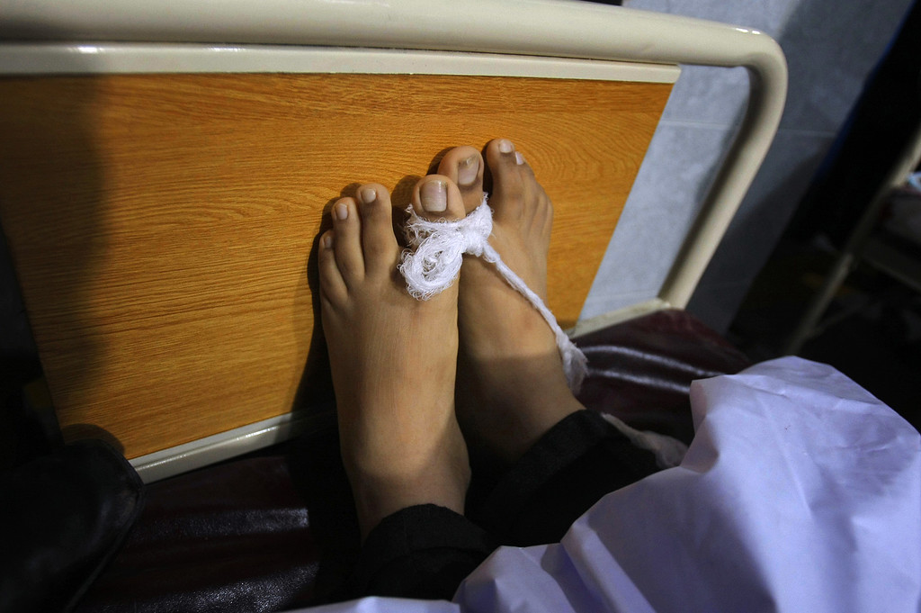 . The feet of a victim of a Taliban attack in a school are tied together  at a local hospital in Peshawar, Pakistan,Tuesday, Dec. 16, 2014. Taliban gunmen stormed a military-run school in the northwestern Pakistani city of Peshawar on Tuesday, killing and wounding scores, officials said, in the highest-profile militant attack to hit the troubled region in months.(AP Photo/Mohammad Sajjad)
