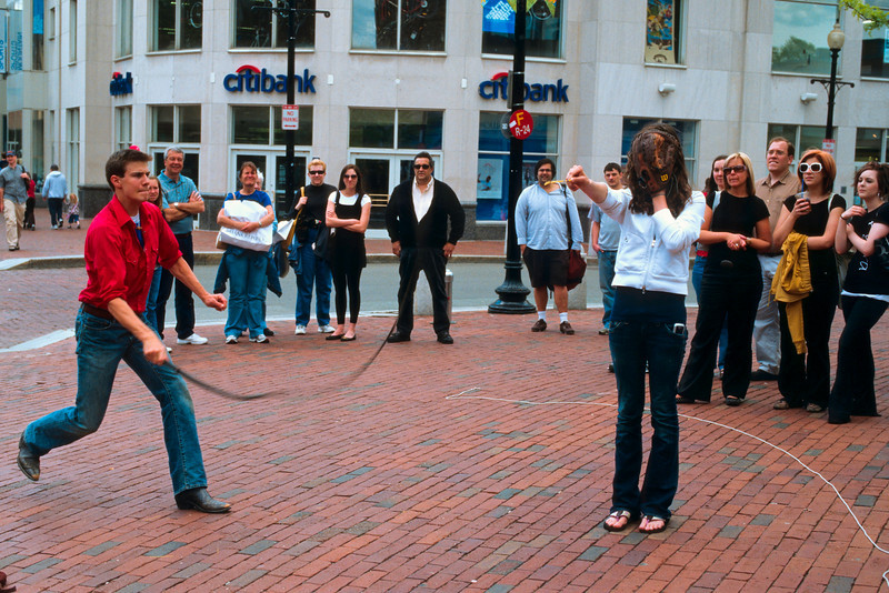 The Street Performance - Her friends look on with a lack of amazement as she has a straw literally whipped from her fingers.