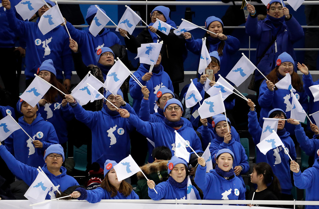 . Korean supporters cheer after the preliminary round of the women\'s hockey game between Sweden and the combined Koreas at the 2018 Winter Olympics in Gangneung, South Korea, Monday, Feb. 12, 2018. Sweden won 8-1. (AP Photo/Julio Cortez)