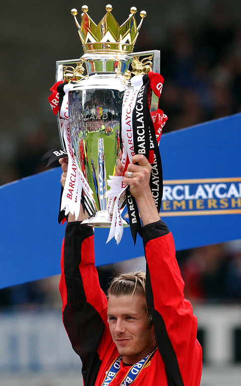 . In a file picture taken on May 11, 2003 Manchester United\'s English midfielder David Beckham celebrates with the Premier league trophy after defeating Everton at Goodison park in Liverpool.  ROBIN PARKER/AFP/Getty Images