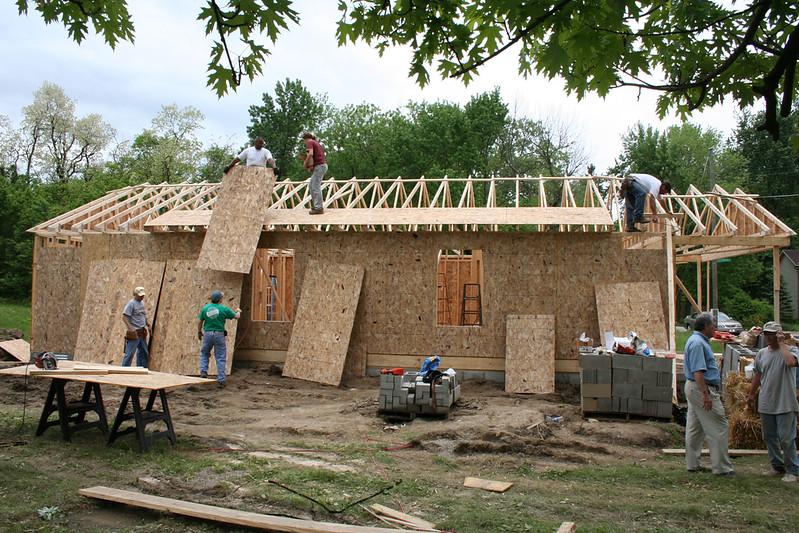 Indianapolis - Sheathing goes up on trusses.