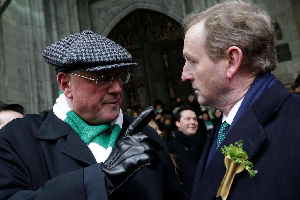 . Cardinal Timothy Dolan, left, talks with Irish Prime Minister Enda Kenny at New York\'s St. Patrick\'s Day parade, Monday, March 17, 2014 in New York. (AP Photo/Mark Lennihan)