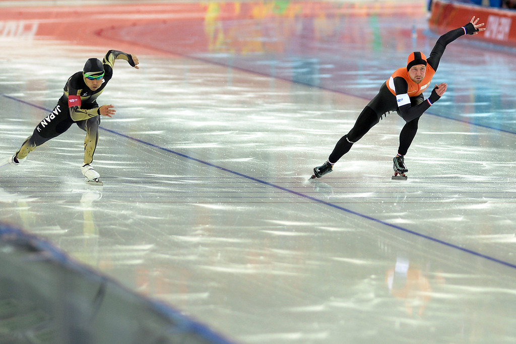 . Gold medalist Michel Mulder (right) leads Japan\'s Keiichiro Nagashima during the speed skating men\'s 500-meter at Adler Arena. Sochi 2014 Winter Olympics on Monday, February 10, 2014. (Photo by AAron Ontiveroz/The Denver Post)