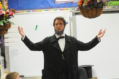 Marshall Street 4th graders hear Bob Gleason portray President Lincoln