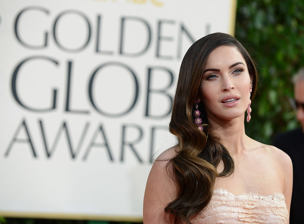 Description of . Actress Megan Fox arrives at the 70th Annual Golden Globe Awards at the Beverly Hilton Hotel on Sunday Jan. 13, 2013, in Beverly Hills, Calif. (Photo by Jordan Strauss/Invision/AP)