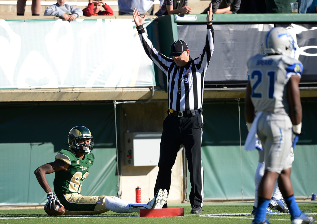 . Colorado State WR, Rashard Higgins, awaits a signal from the ref and gets it for a touchdown against Air Force celebrates his touchdown against Air Force in the second quarter at Hughes Stadium  Saturday afternoon, November 30, 2013. The Rams won 58-13. (Photo By Andy Cross/The Denver Post)