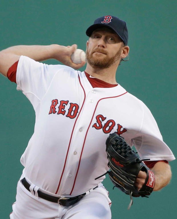 . Boston Red Sox starting pitcher Ryan Dempster delivers to the Minnesota Twins during the first inning of a baseball game at Fenway Park in Boston, Tuesday, May 7, 2013. (AP Photo/Elise Amendola)