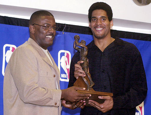 . Detroit Pistons president of basketball operations Joe Dumars, left, presents the 2001-2002 NBA Sixth Man Award to forward Corliss Williamson during a ceremony at the Palace of Auburn Hills, Mich., Tuesday, April 23, 2002. Williamson averaged 13.6 points, 4.2 rebounds and 1.2 assists, starting just seven of the 78 games he played. (AP Photo/Carlos Osorio)