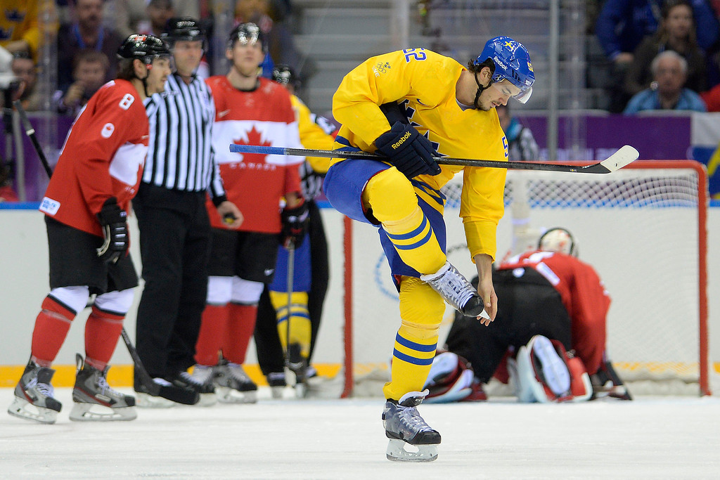 . Jonathan Ericsson (52) of Sweden clears his skates during the first period of the men\'s ice hockey gold medal game. Sochi 2014 Winter Olympics on Sunday, February 23, 2014 at Bolshoy Ice Arena. (Photo by AAron Ontiveroz/ The Denver Post)